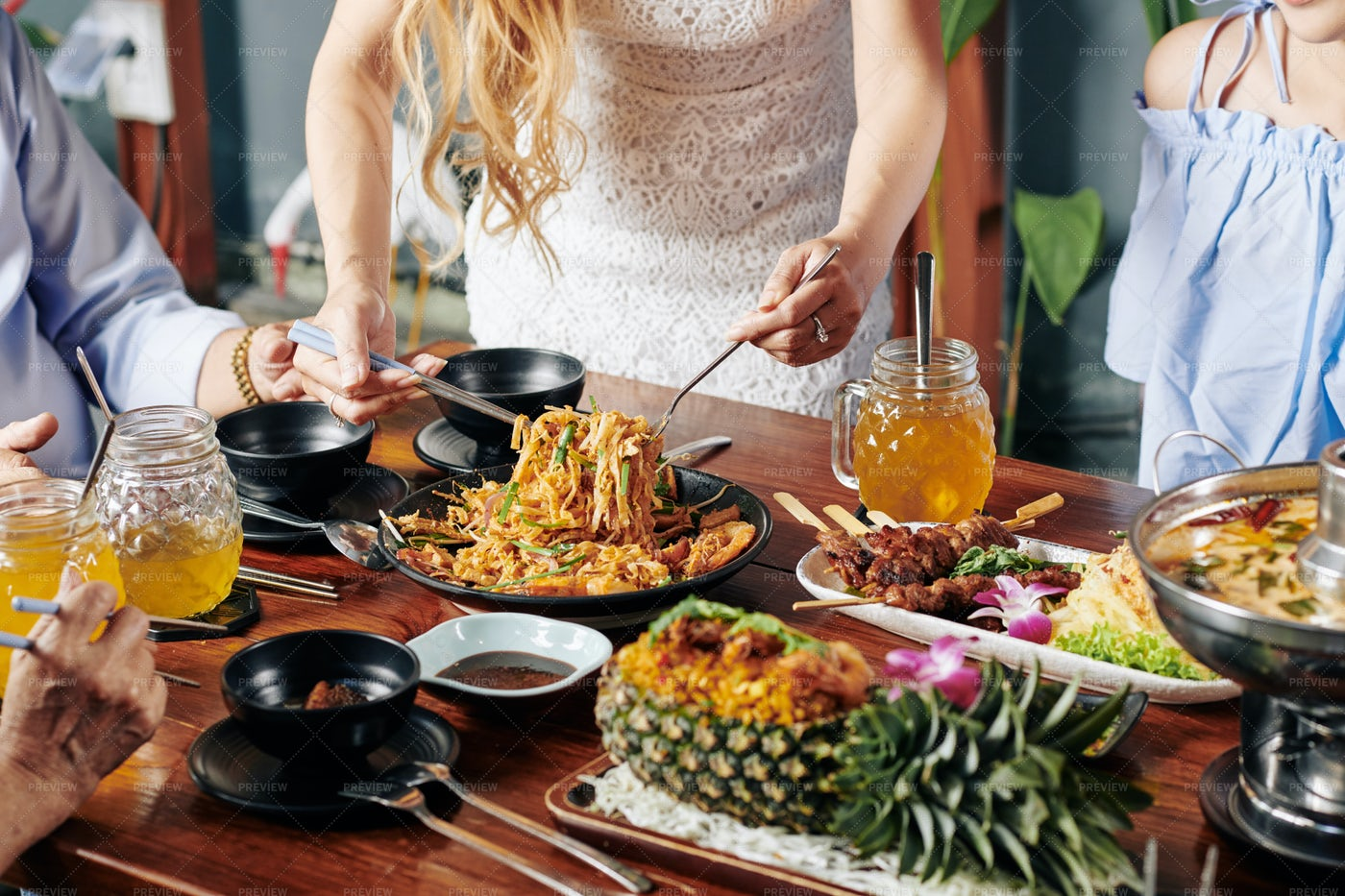 Housewife Serving Food At Dinner: Stock Photos