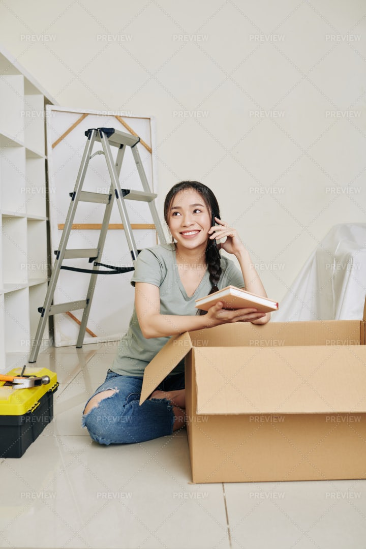 Woman Unpacking In New House: Stock Photos