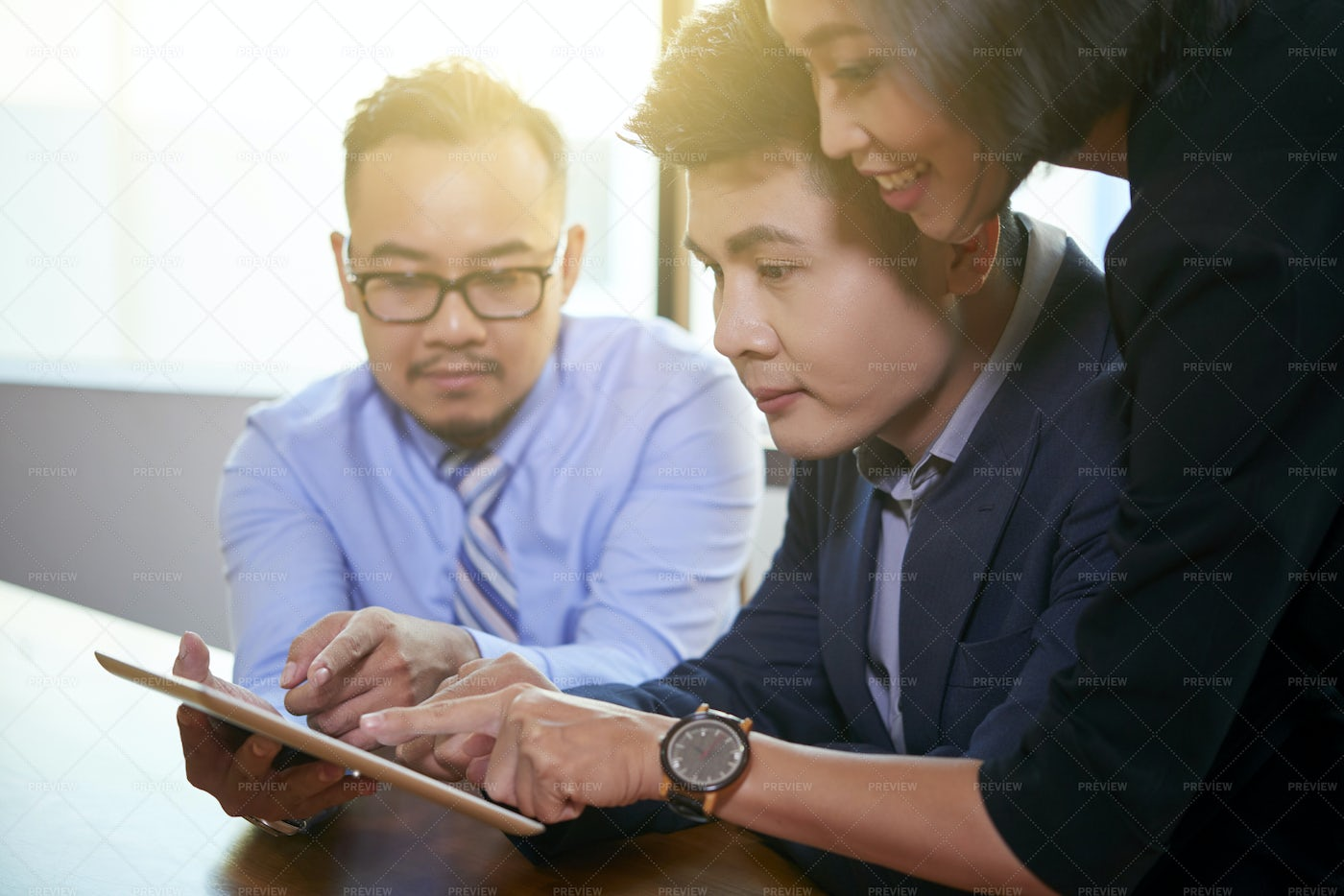 Business Team Working On Tablet: Stock Photos