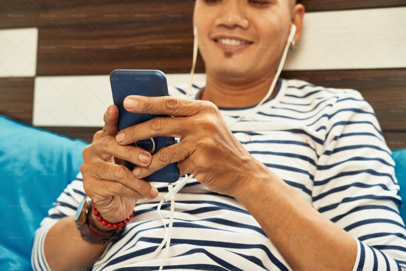 Man Playing Game On Smartphone: Stock Photos