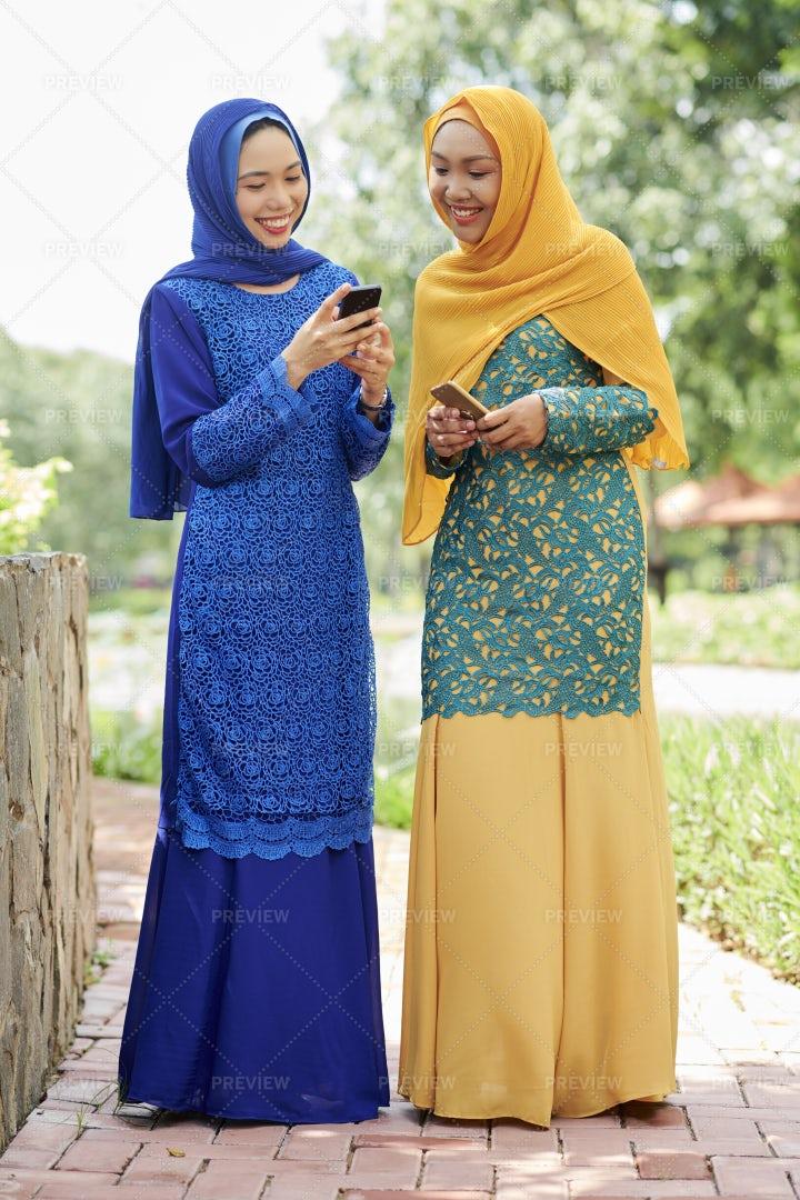 Pretty Muslim Women With Smartphones: Stock Photos