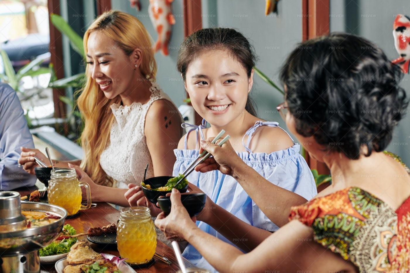Preteen Girl Enjoying Family Dinner: Stock Photos