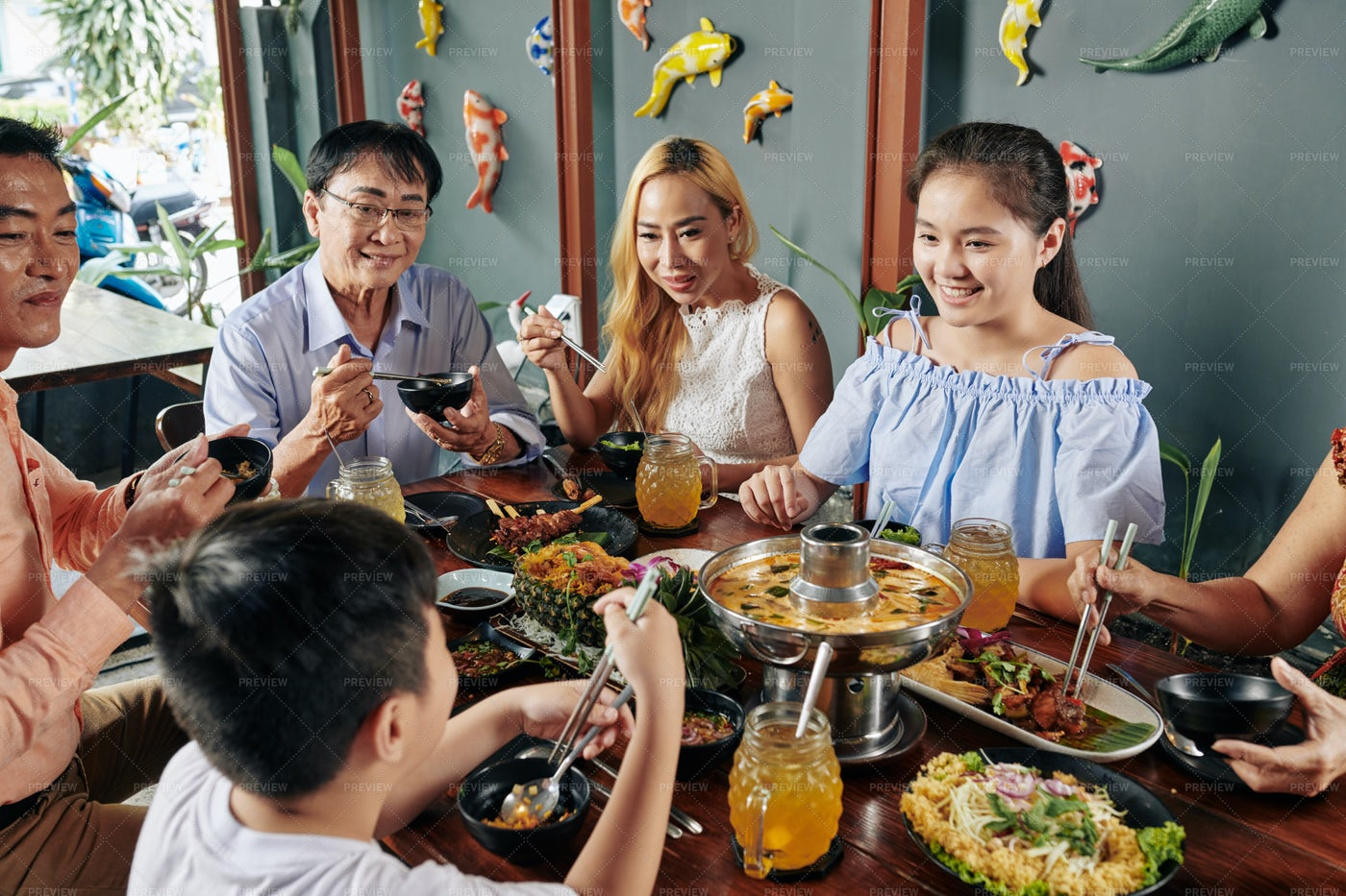 Happy Family Eating Dinner Together: Stock Photos