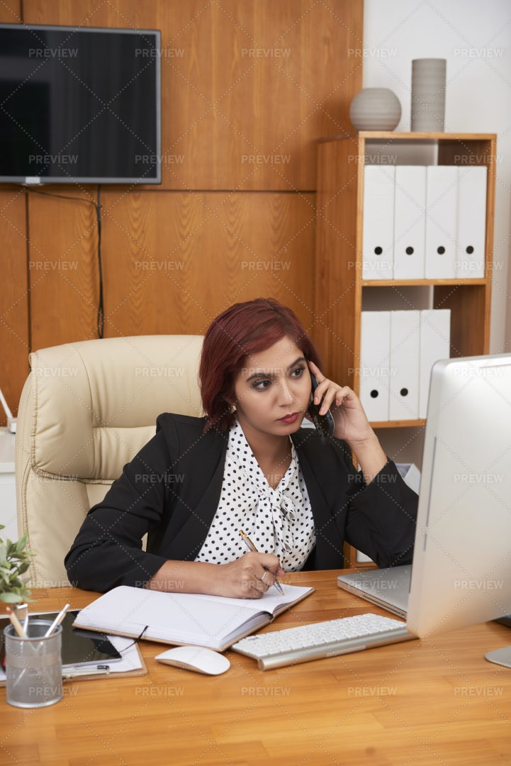 Busy Woman Working At Her Office: Stock Photos