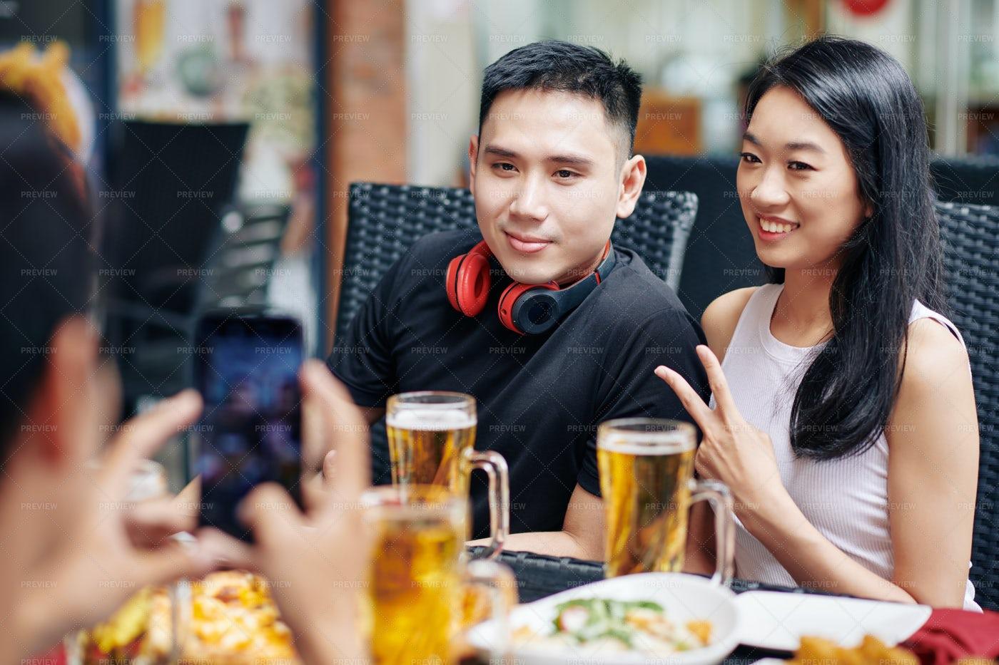 Asian Couple Posing At Camera: Stock Photos