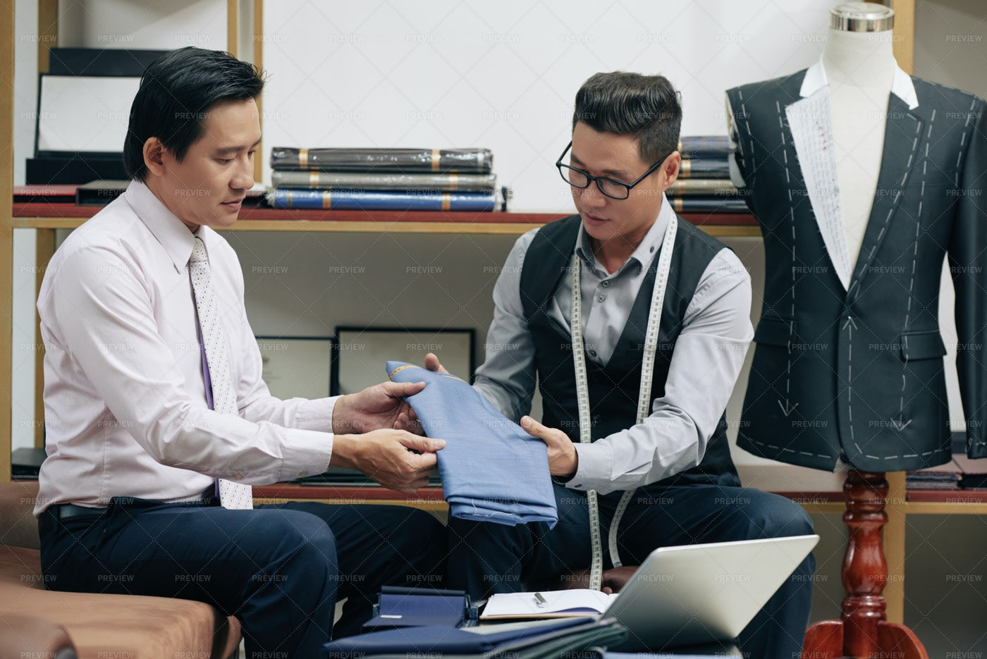 Tailor Showing New Fabric: Stock Photos