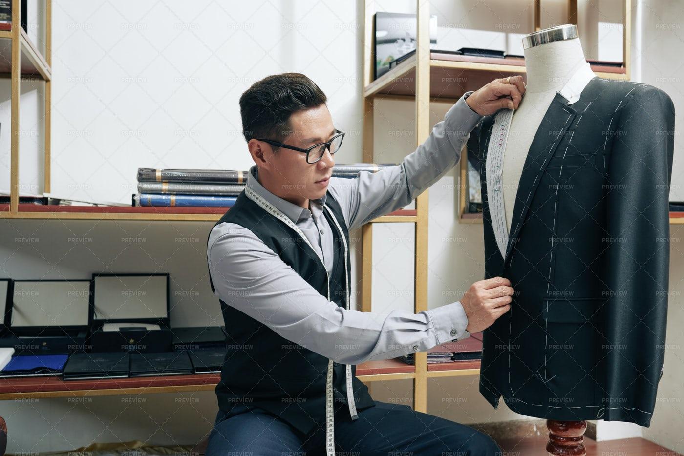 Tailor Measuring Suit Jacket: Stock Photos