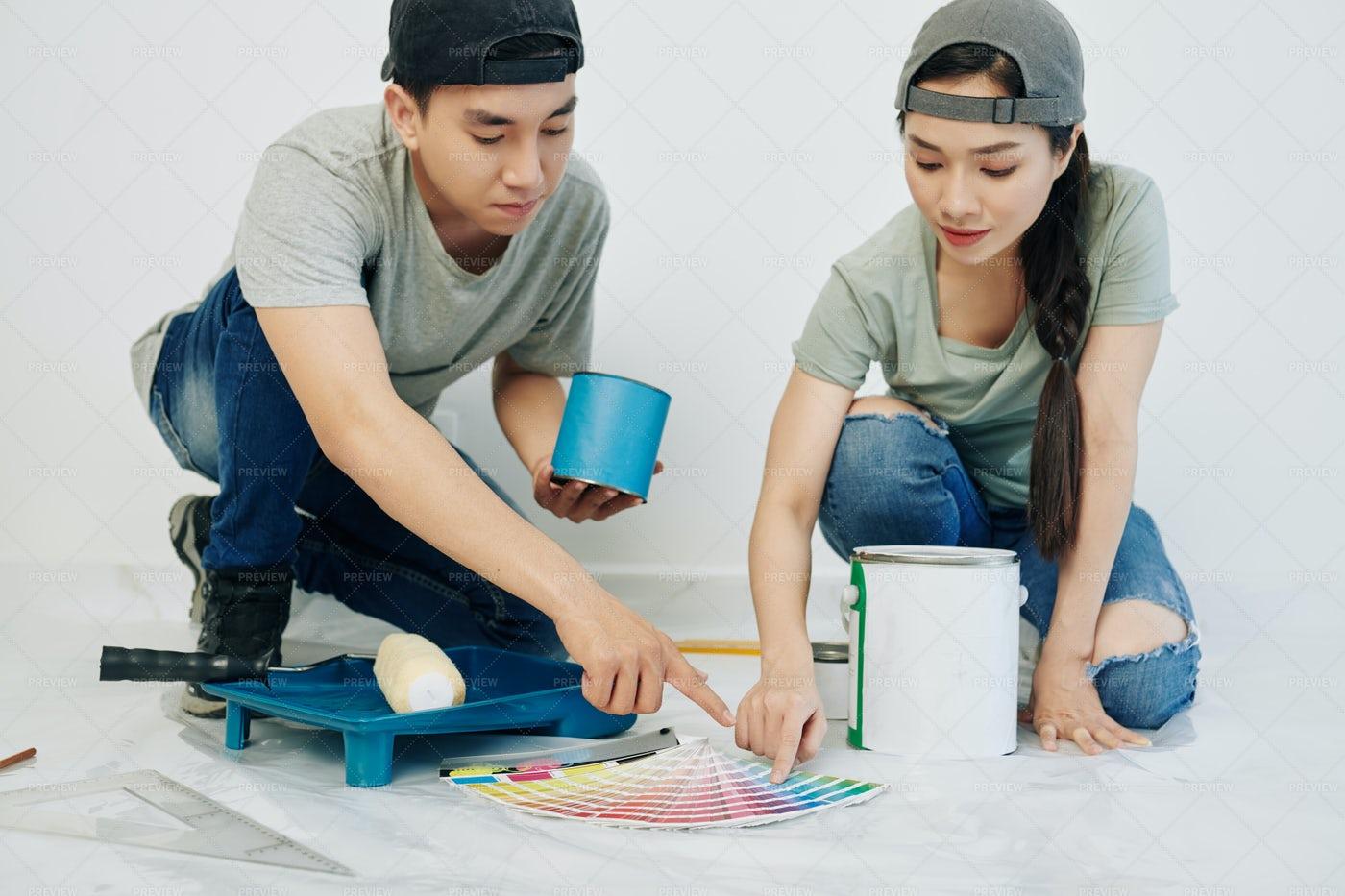 Young Couple Choosing Walls Color: Stock Photos