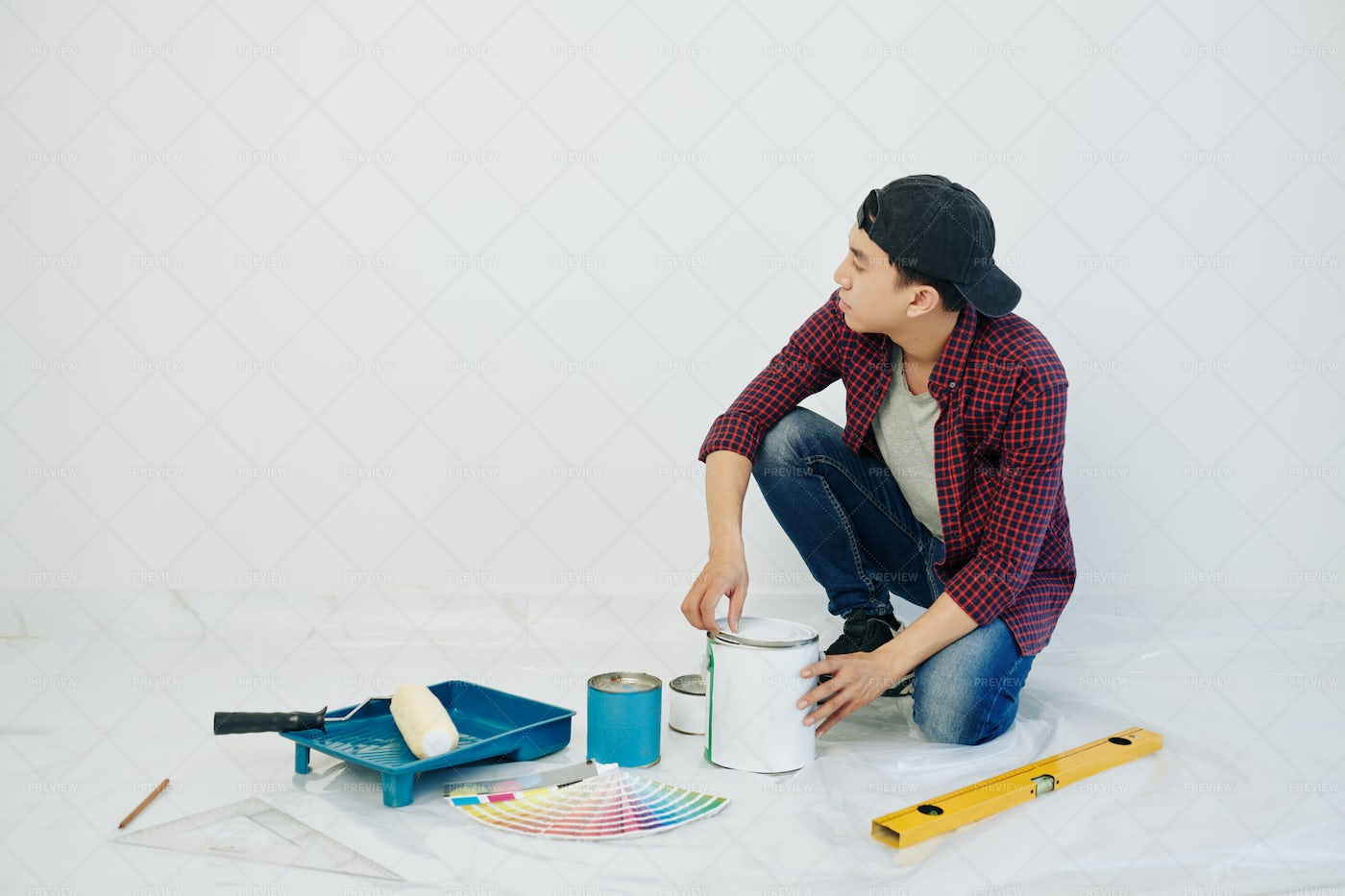 Man Opening Can Of Paint: Stock Photos
