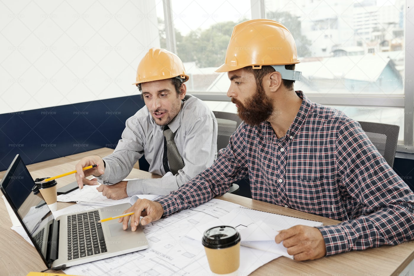 Engineers Discussing Project In Laptop: Stock Photos