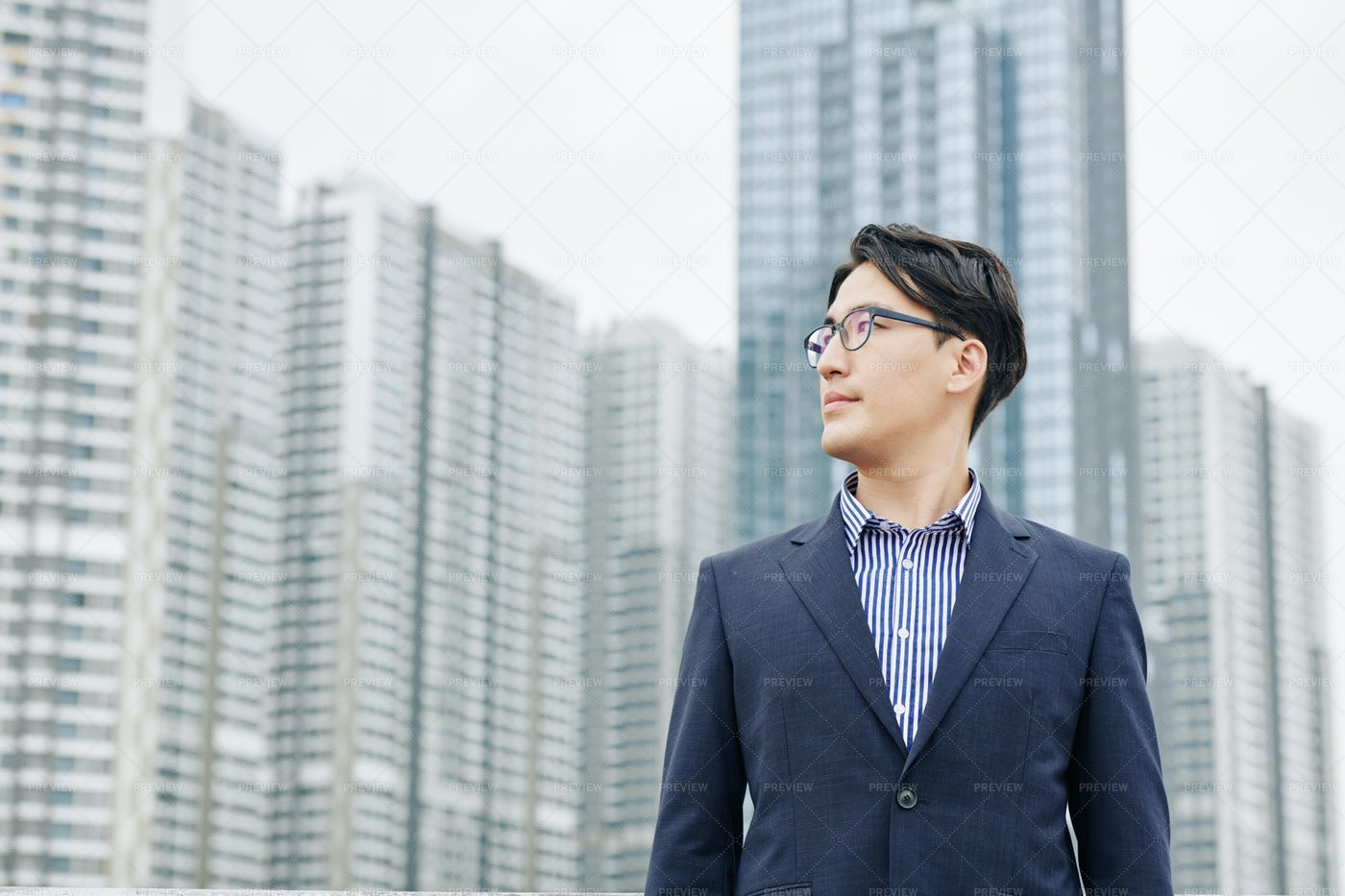 Businessman Looking At New District: Stock Photos