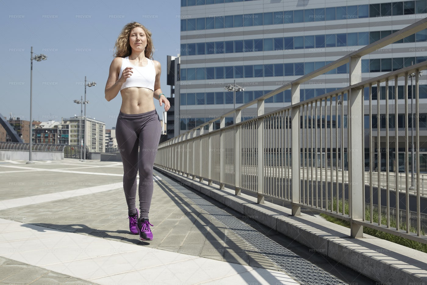 Woman Running In The City: Stock Photos