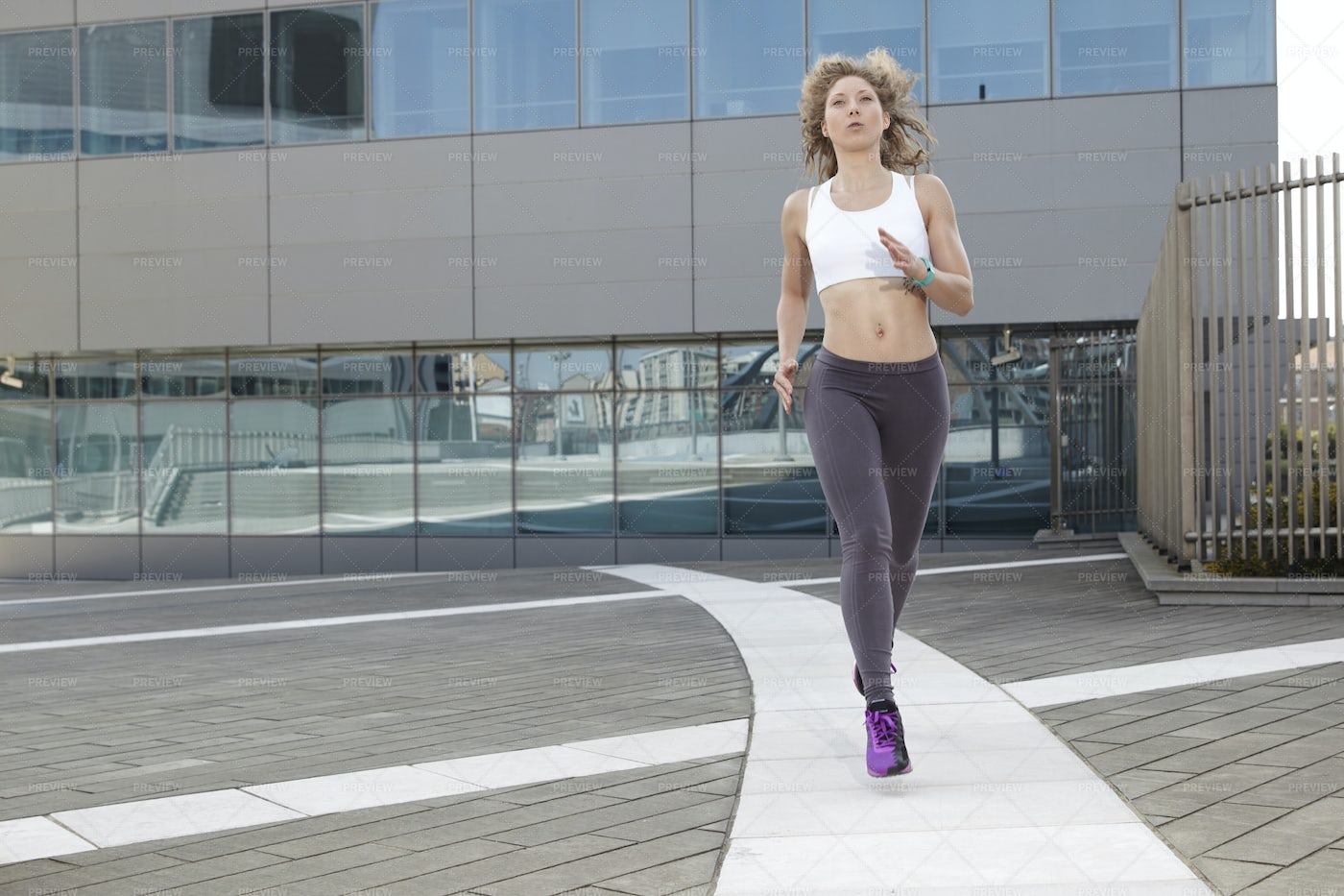 Female Running In The City: Stock Photos
