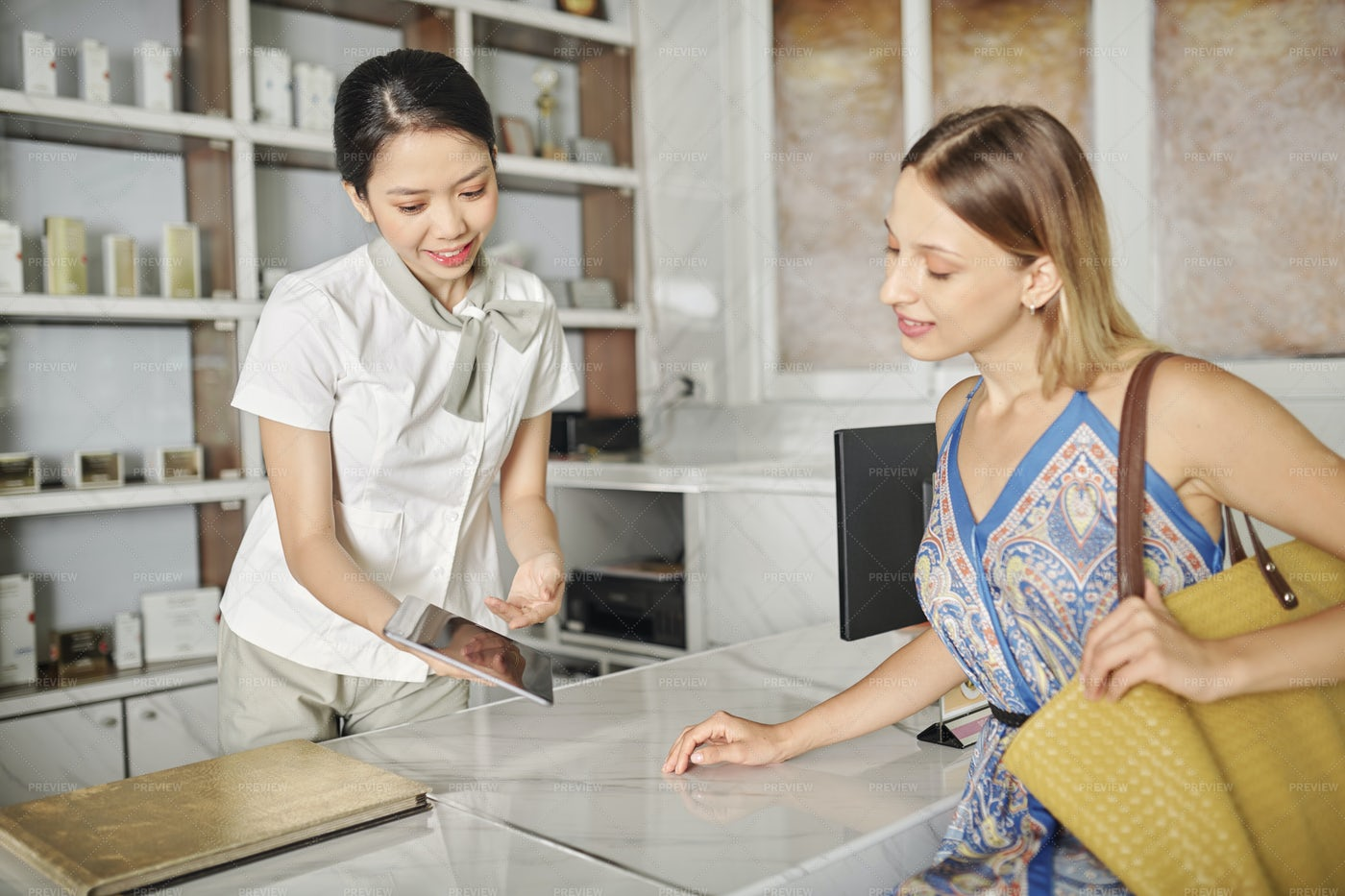 Receptionists Showing Catalog: Stock Photos