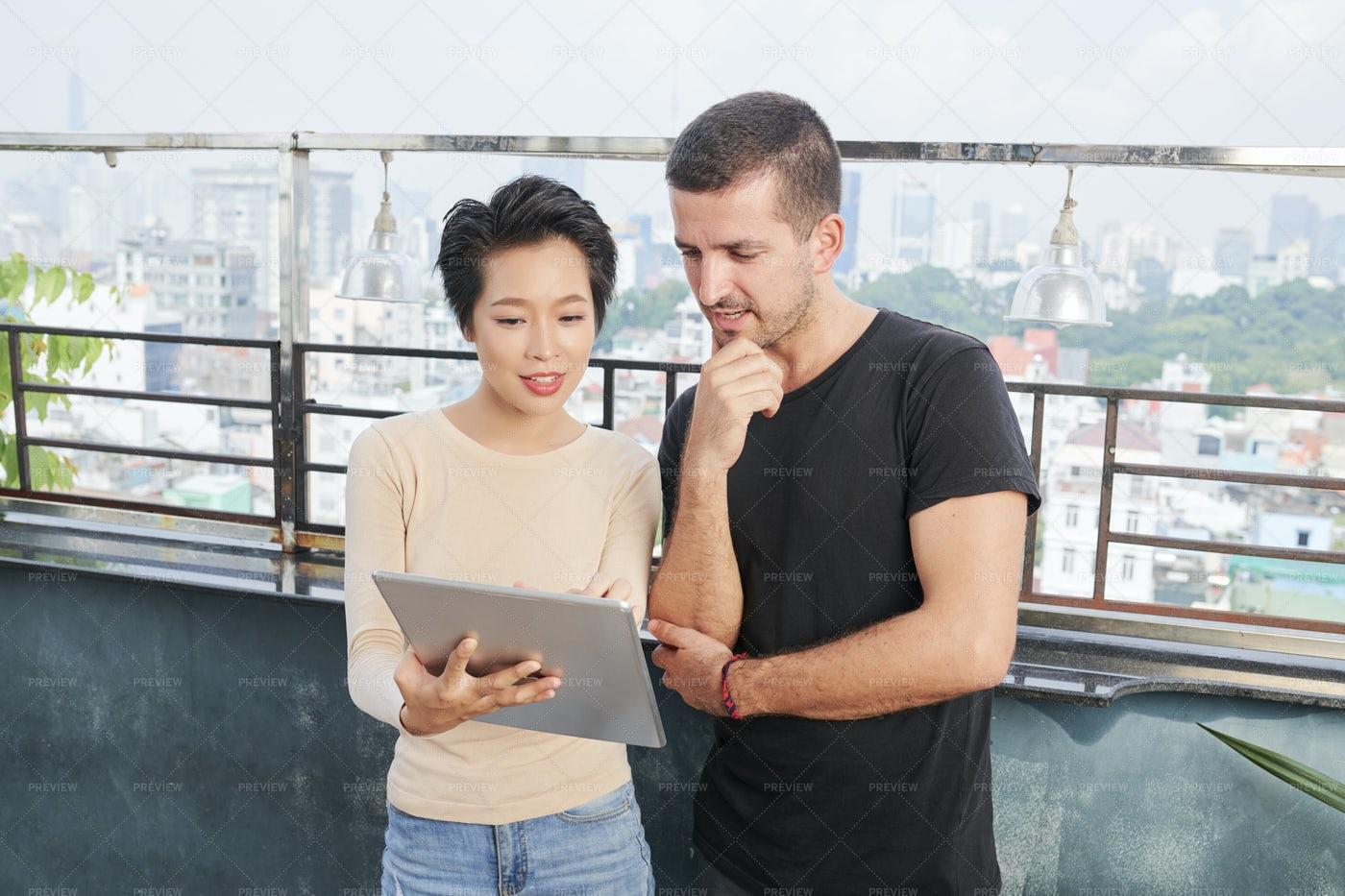 Multiethnic Couple Using Digital Tablet: Stock Photos
