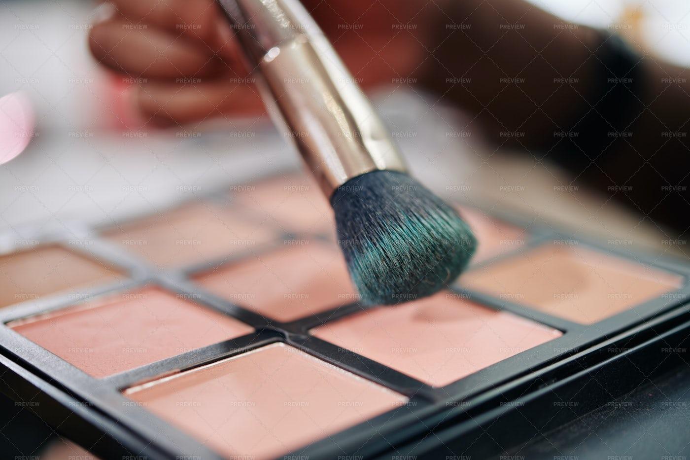 Make-up Artist Applying Blush: Stock Photos
