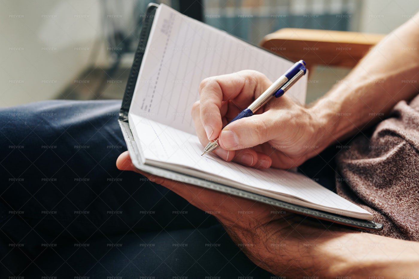 Man Writing Down Thoughts: Stock Photos