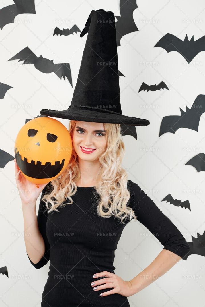 Pretty Sorceress With Scary Orange: Stock Photos
