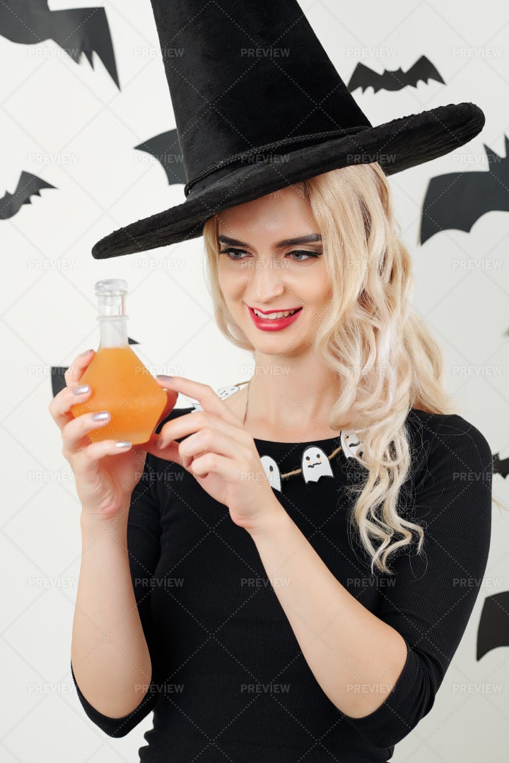 Sorceress With Potion Bottle: Stock Photos