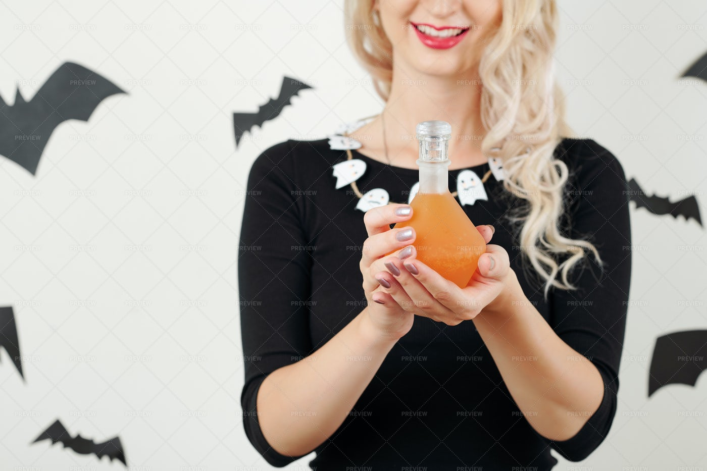 Smiling Witch Holding Poisonous Potion: Stock Photos