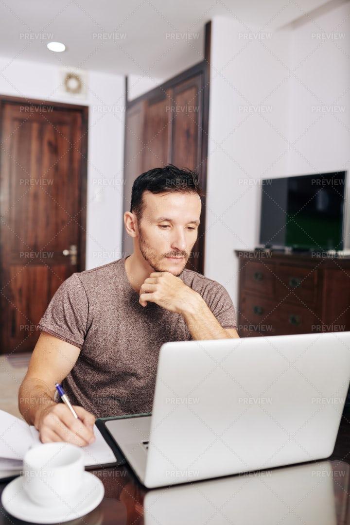 Serious Young Man Watching Webinar: Stock Photos