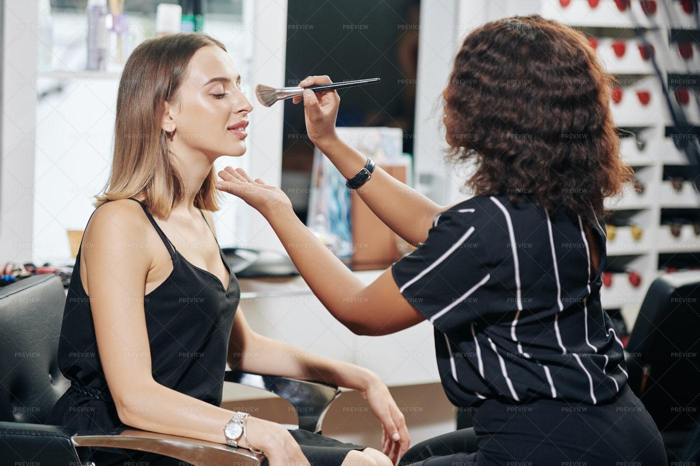 Make-up Artist Applying Finishing Face: Stock Photos