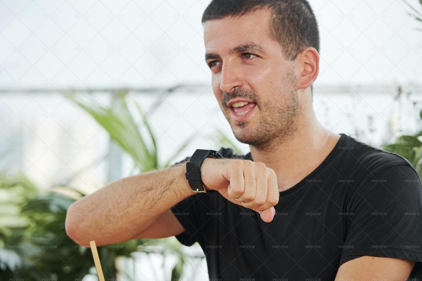 Man Using Smartwatch For Conversation: Stock Photos