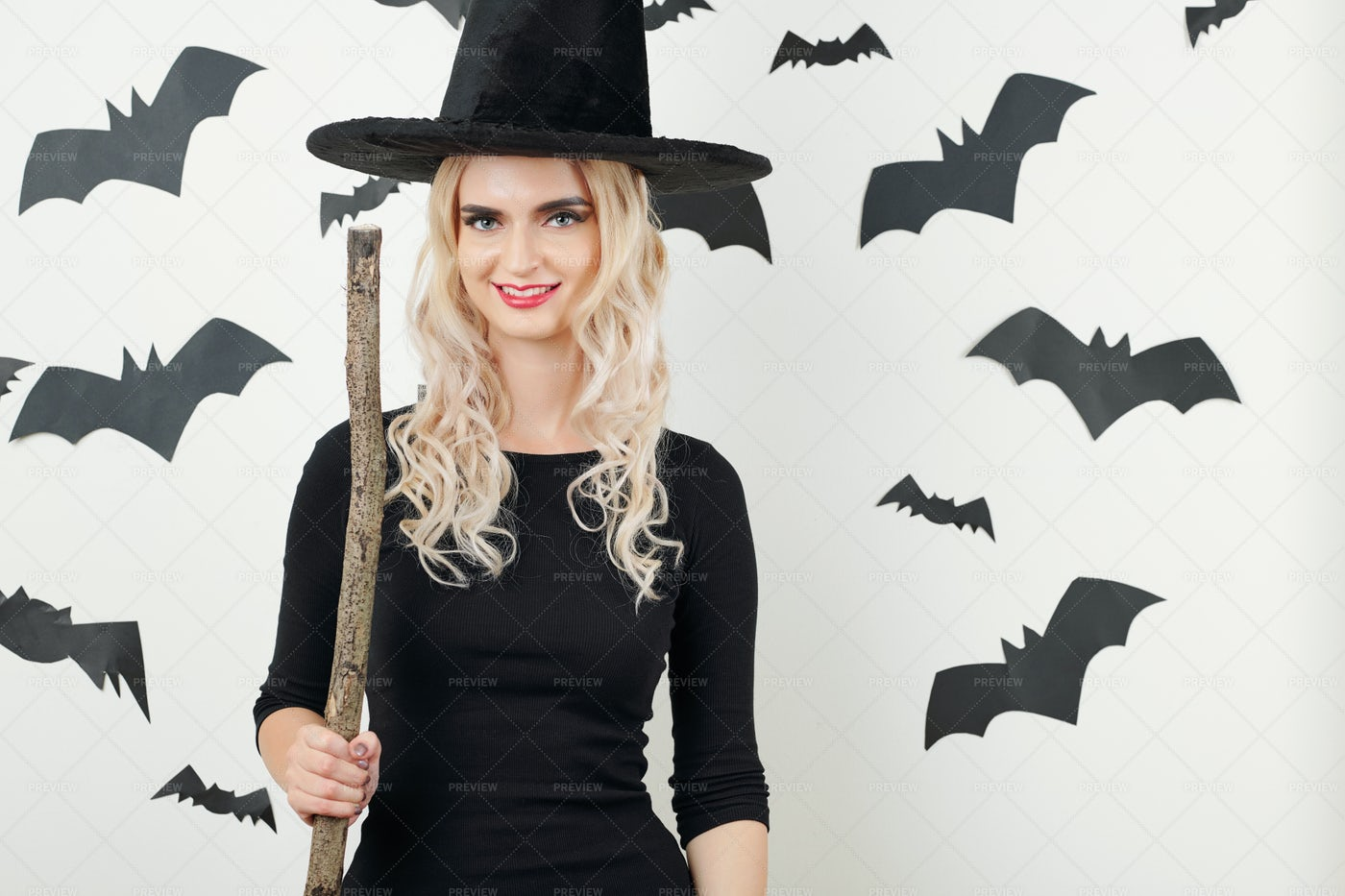 Pretty Witch Posing With Broom: Stock Photos