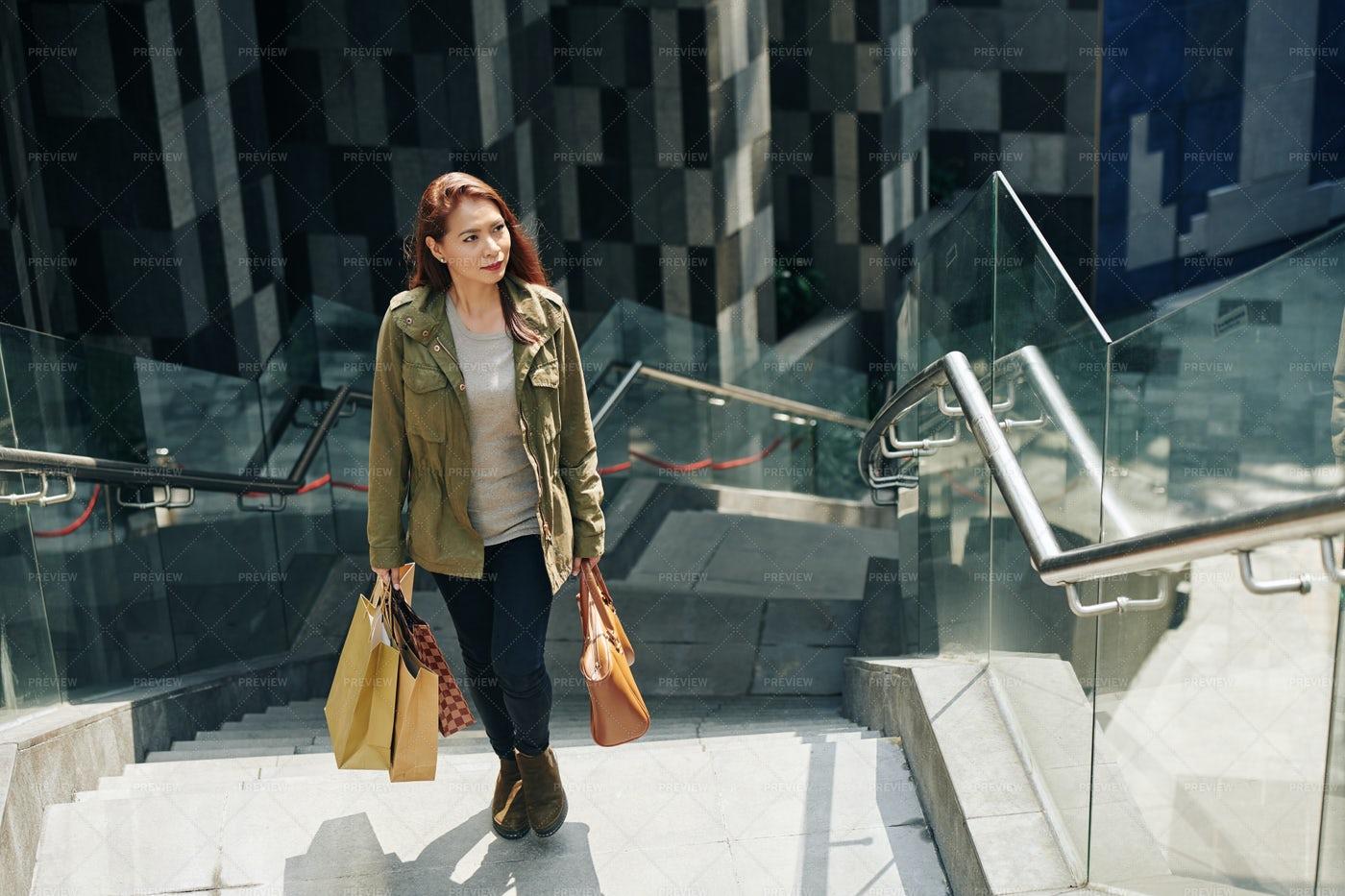 Woman Carrying Shopping Bags: Stock Photos