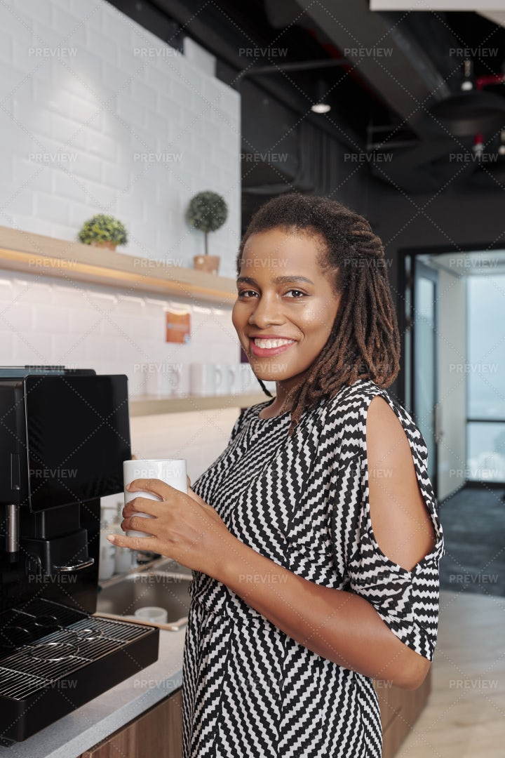 Smiling Businesswoman With Coffee Cup: Stock Photos