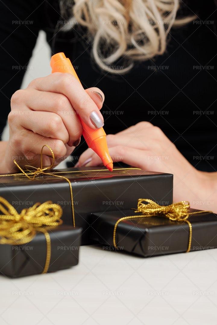 Woman Signing Halloween Presents: Stock Photos