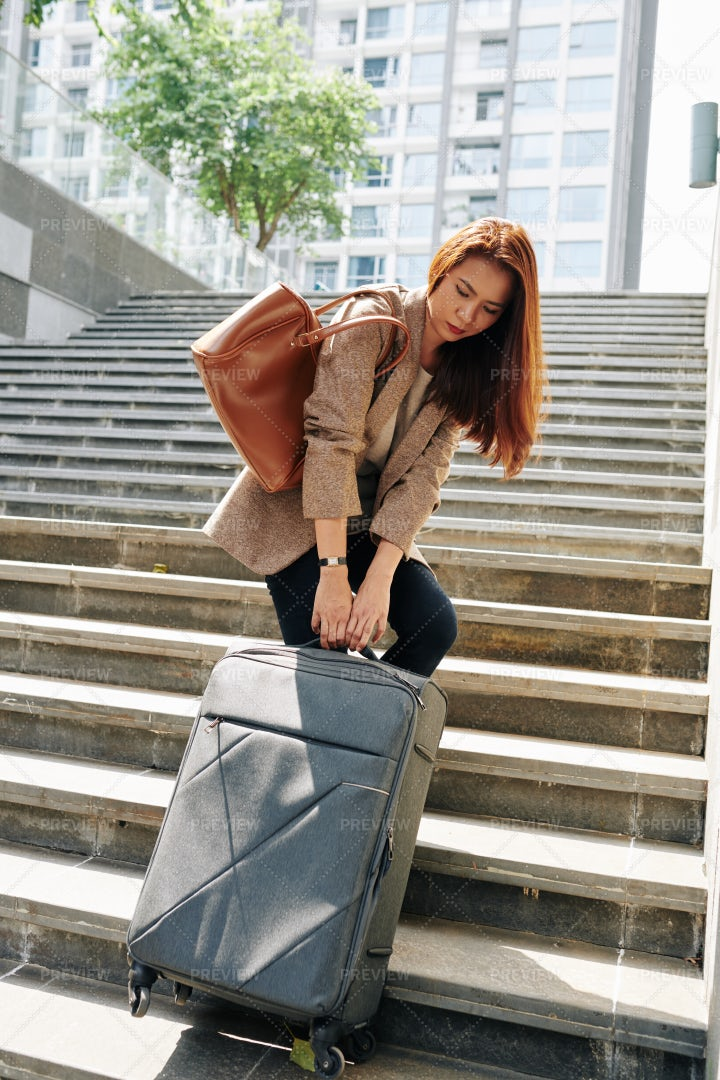 Woman With Heavy Luggage: Stock Photos