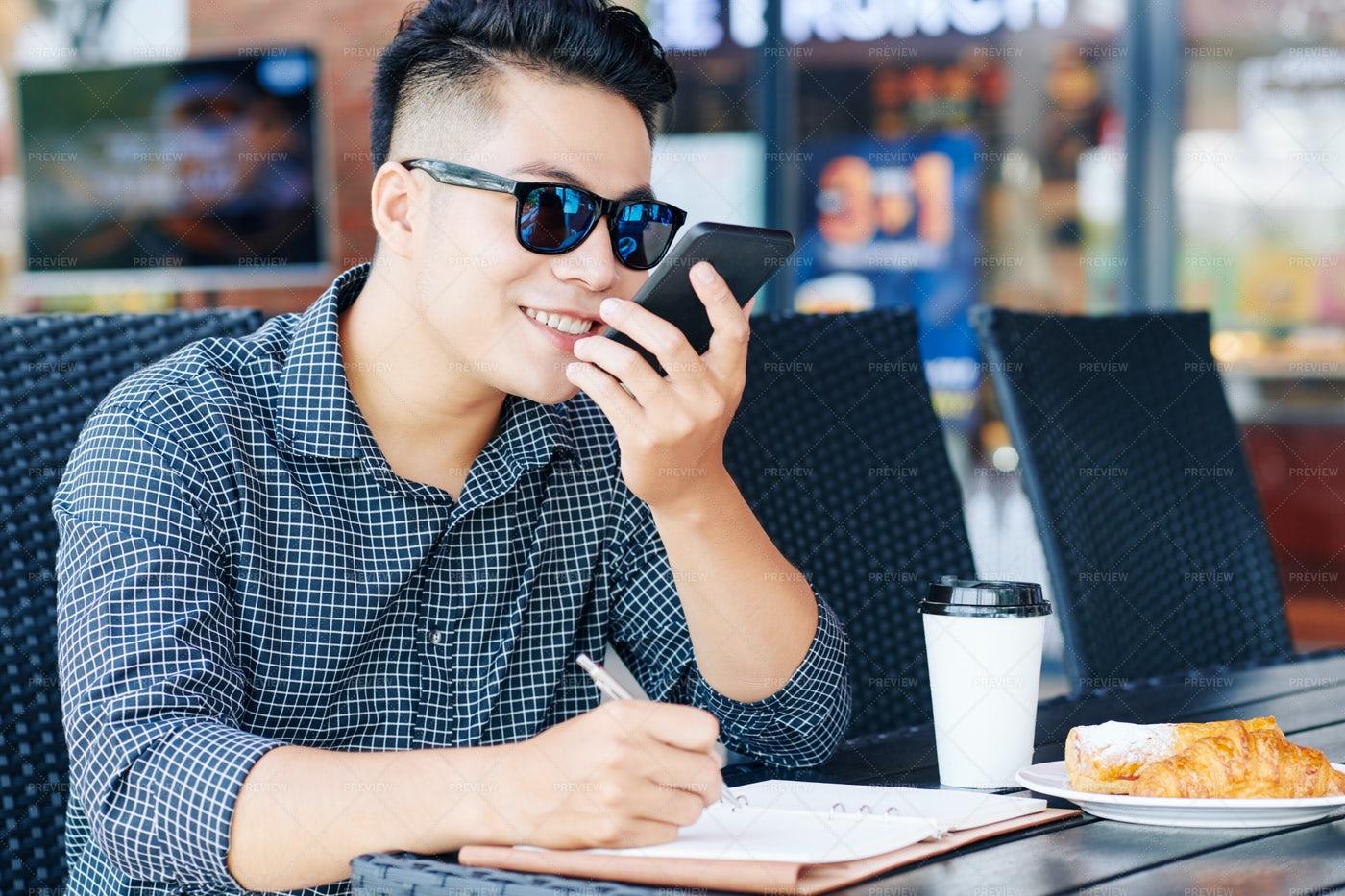 Man Recording Voice Message: Stock Photos