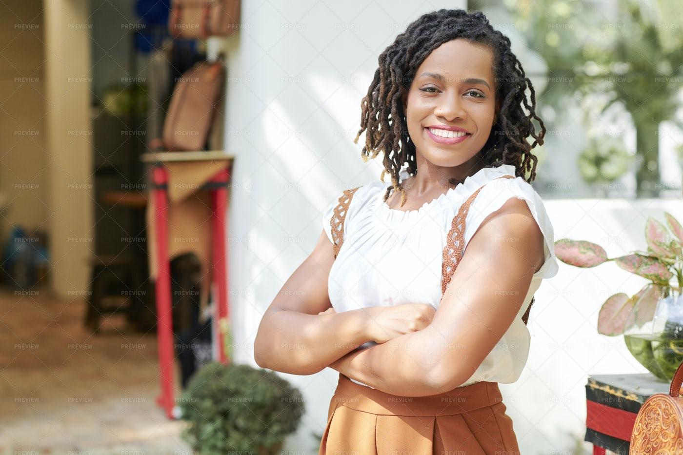 African Woman Standing Outdoors: Stock Photos