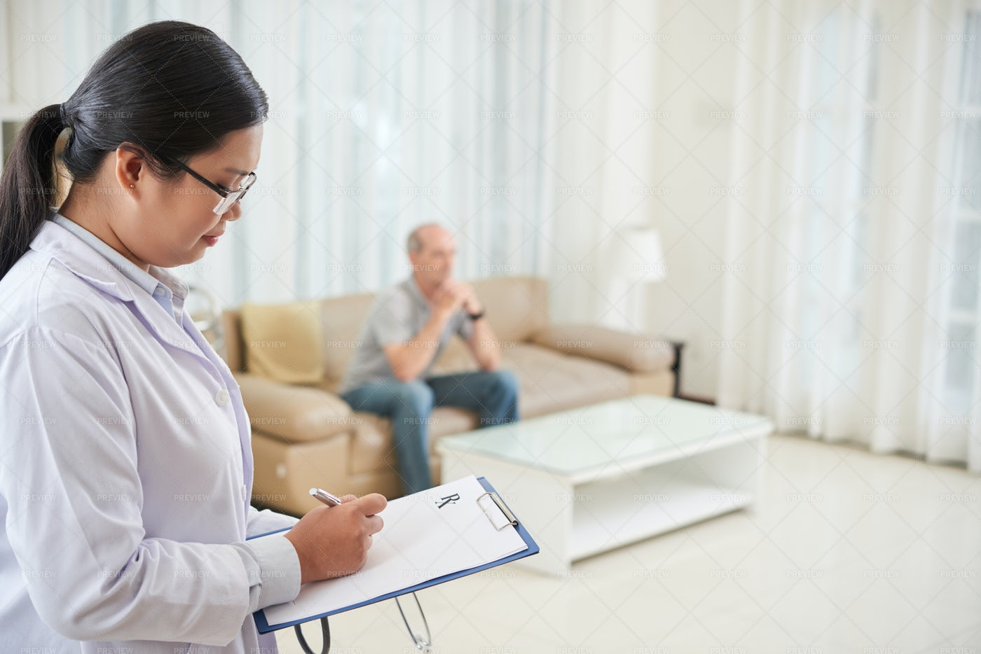 Doctor Writing Prescription: Stock Photos