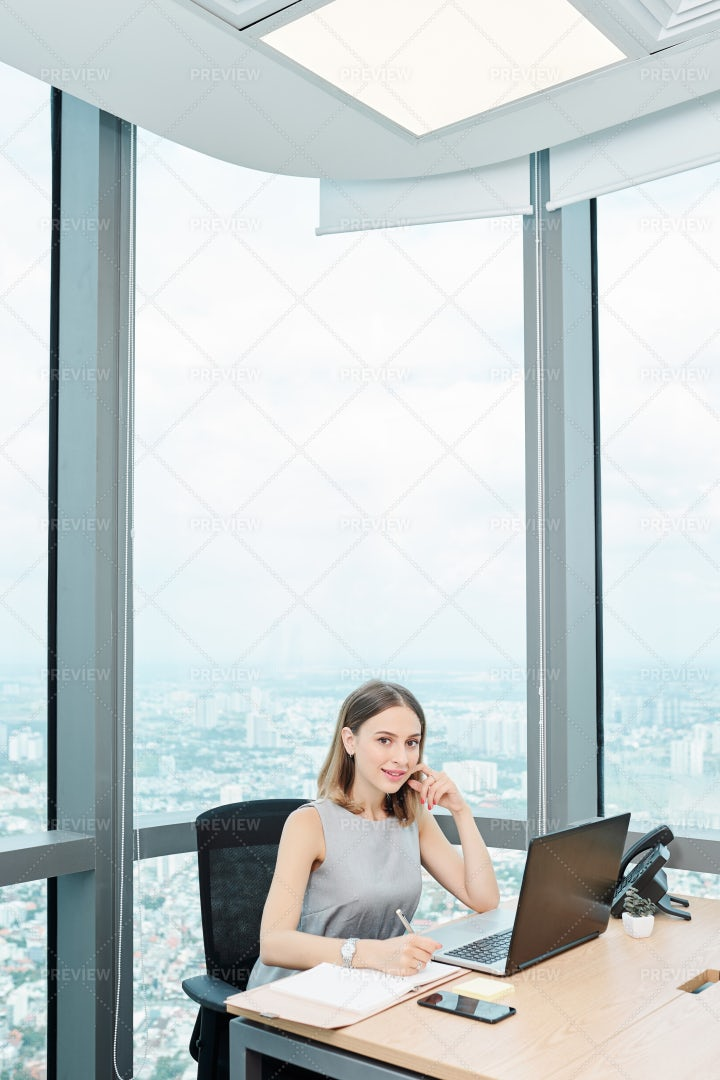 Businesswoman Working At Office Table: Stock Photos