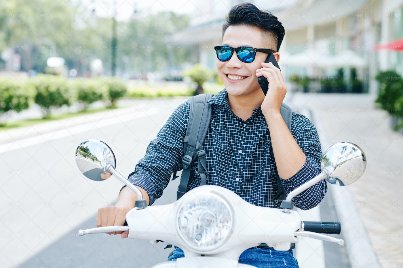 Smiling Man Riding On Scooter: Stock Photos