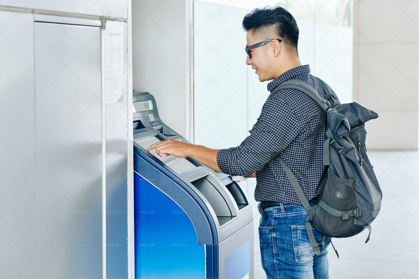 Man Entering Pin Code In ATM Terminal: Stock Photos
