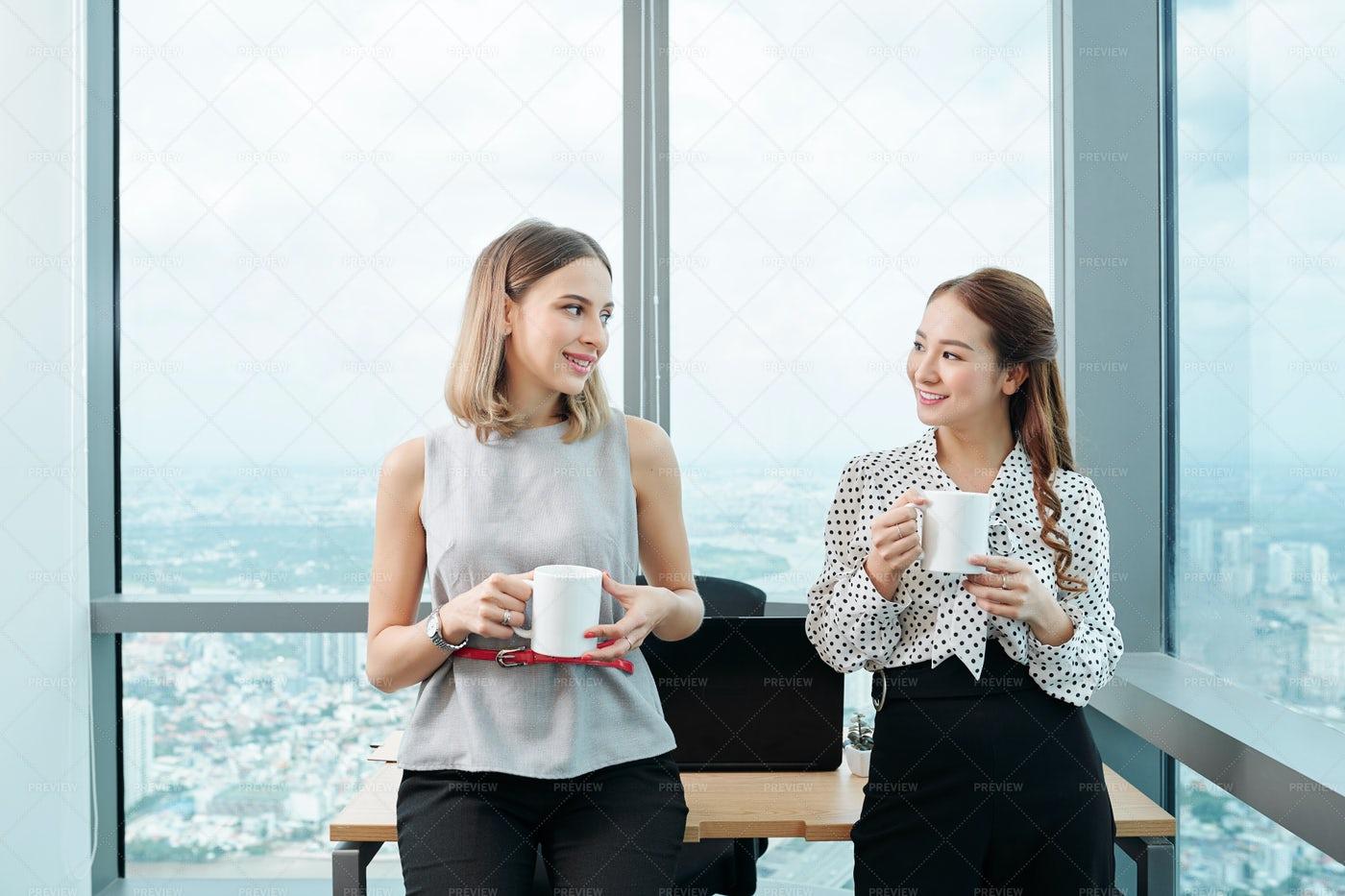 Female Colleagues Enjoying Short Break: Stock Photos