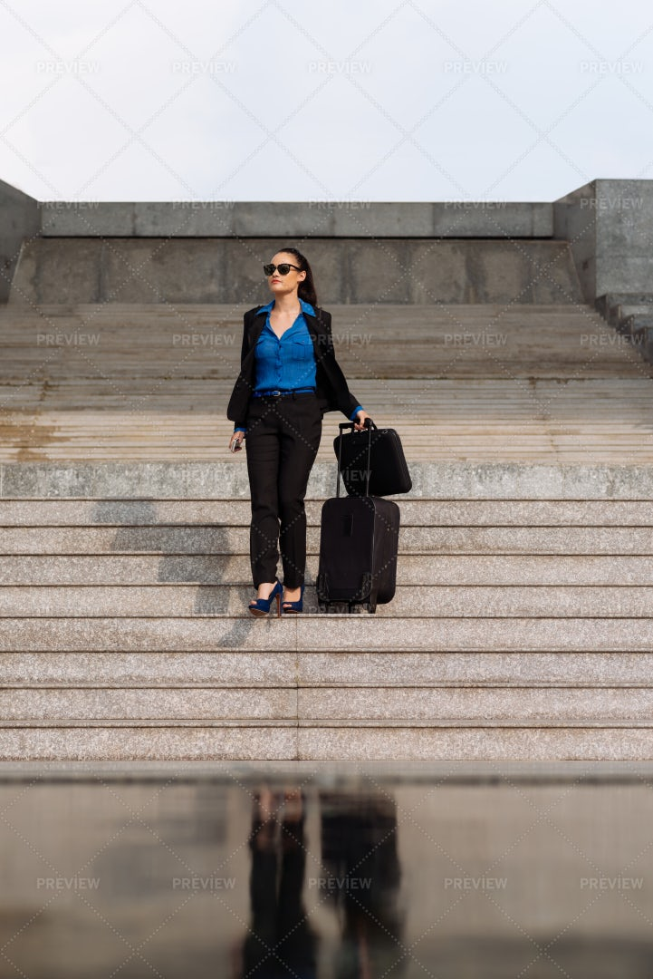 Business Lady With Suitcase On Steps: Stock Photos