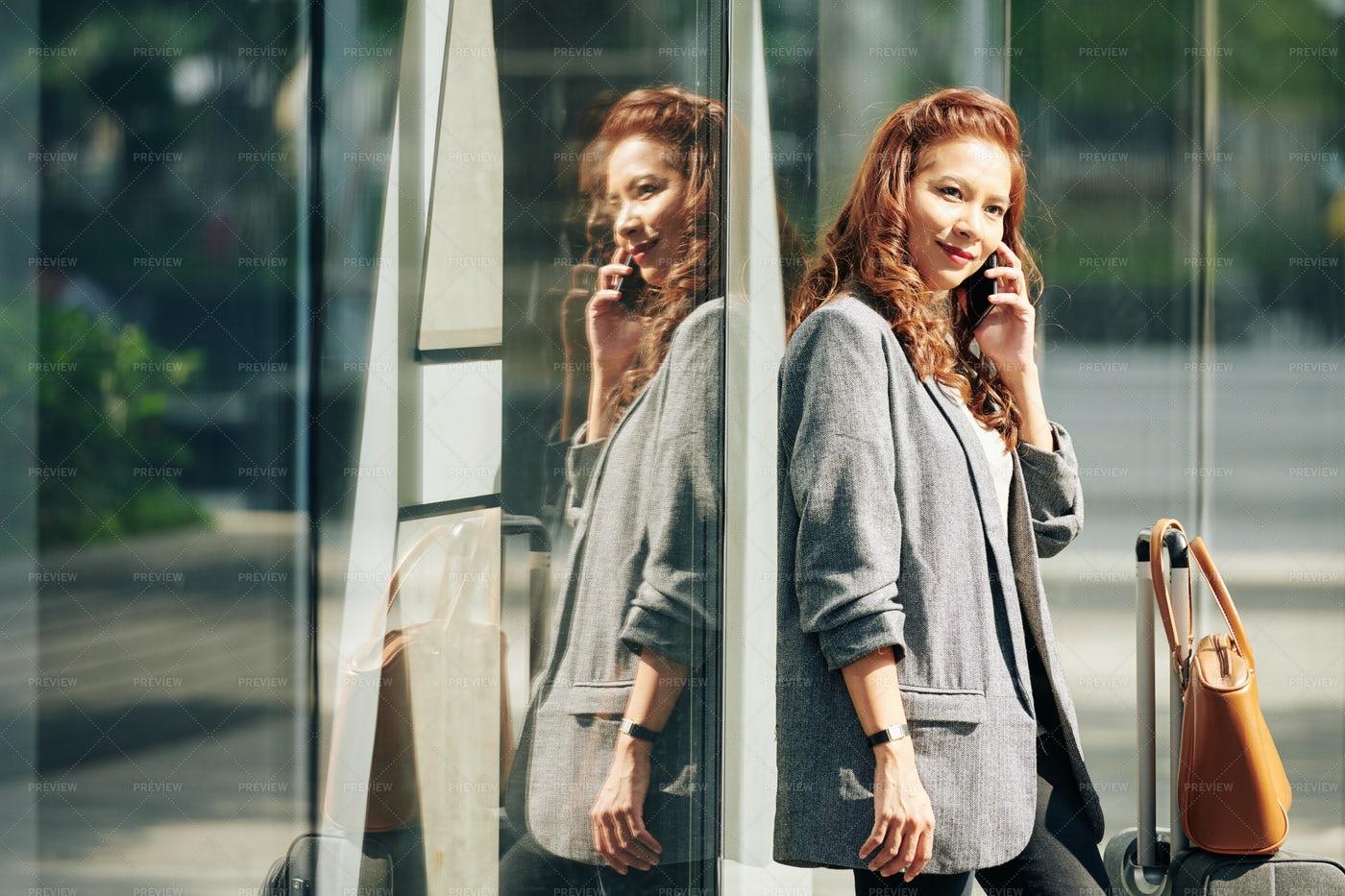 Woman Calling To Taxi Company: Stock Photos