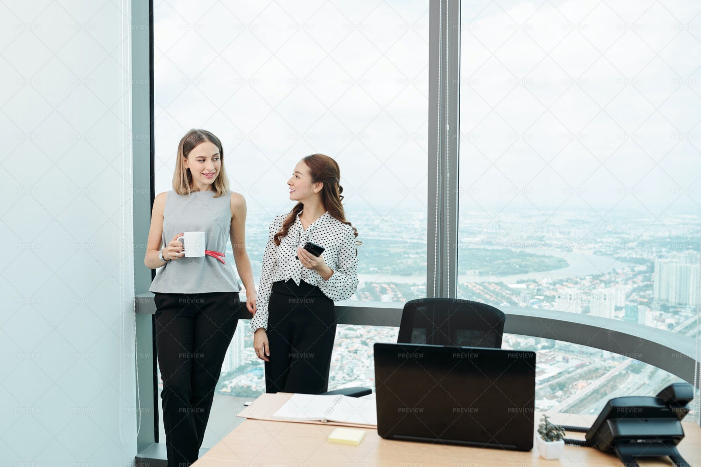 Gossiping Female Coworkers: Stock Photos