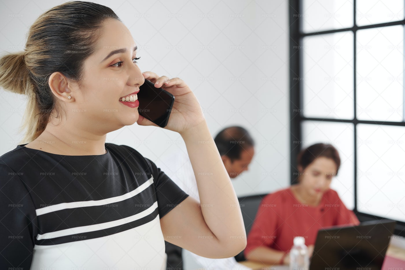 Businesswoman Working On The Phone At: Stock Photos