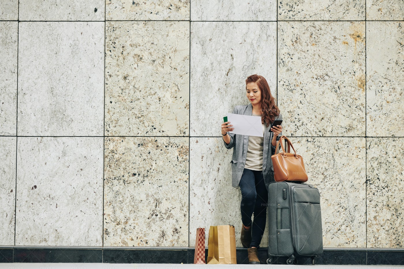 Woman Checking Boarding Pass: Stock Photos