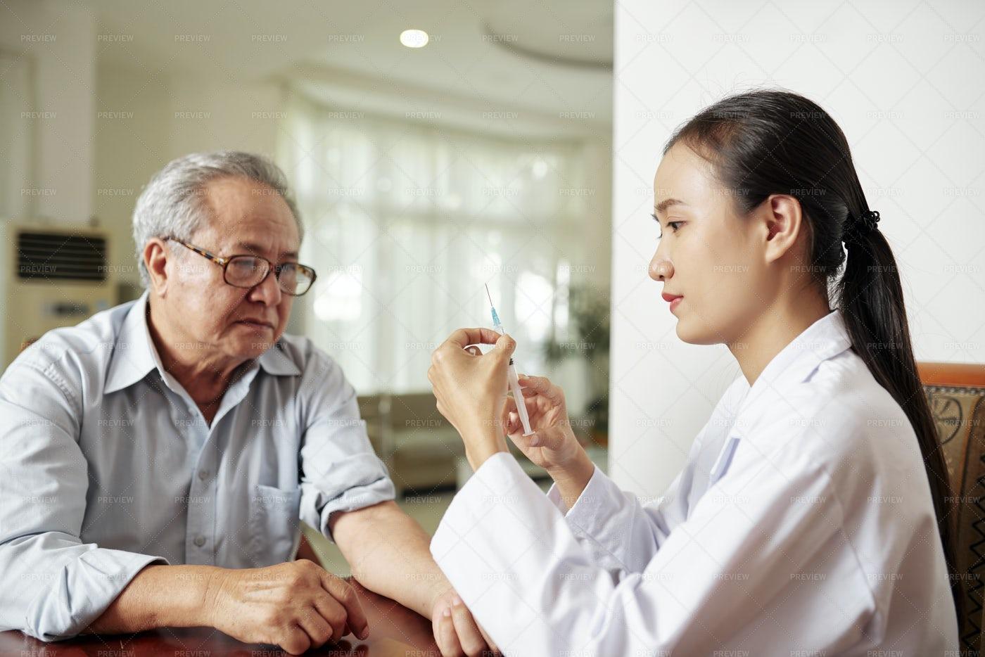 Nurse Making A Vaccination: Stock Photos