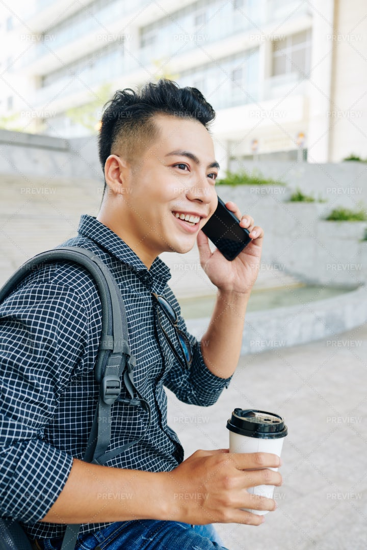 Cheerful Asian Man Talking On Phone: Stock Photos