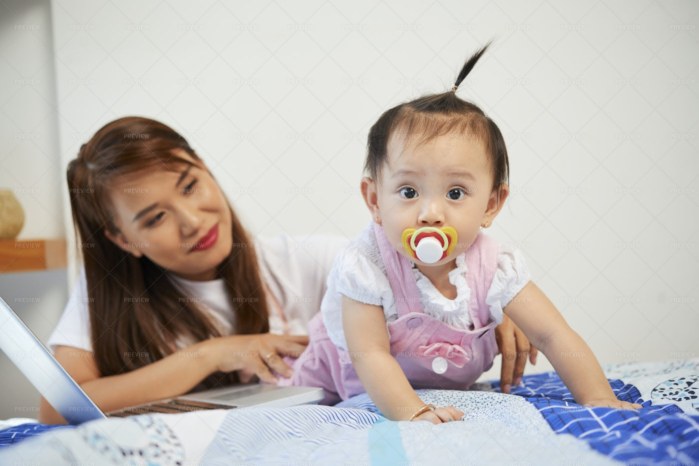 Crawling Baby With Pacifier: Stock Photos