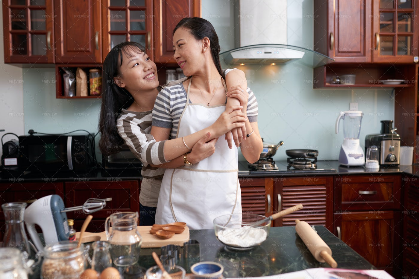 Mother And Daughter Cooking Breakfast: Stock Photos