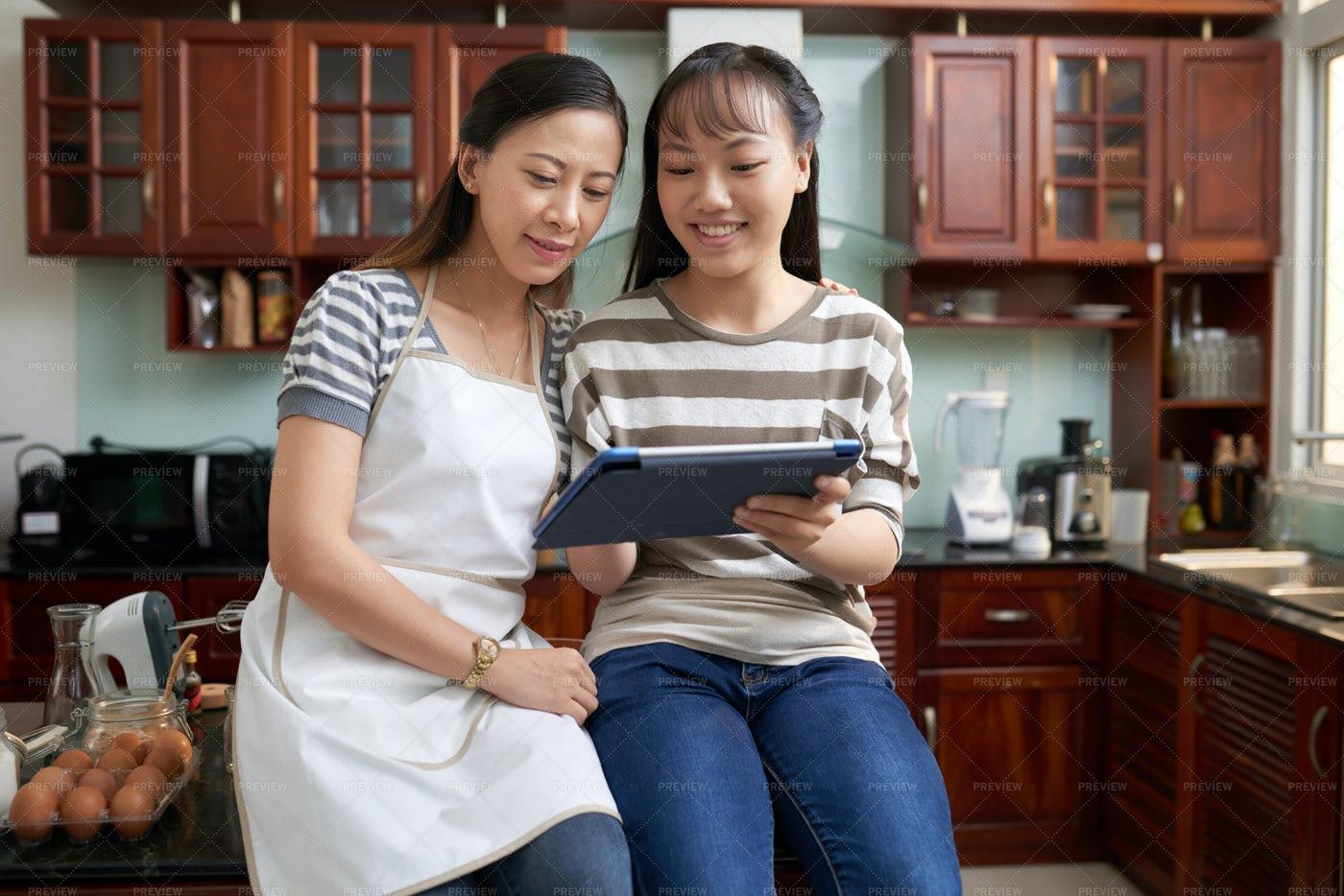 Mother And Daughter Reading Recip: Stock Photos