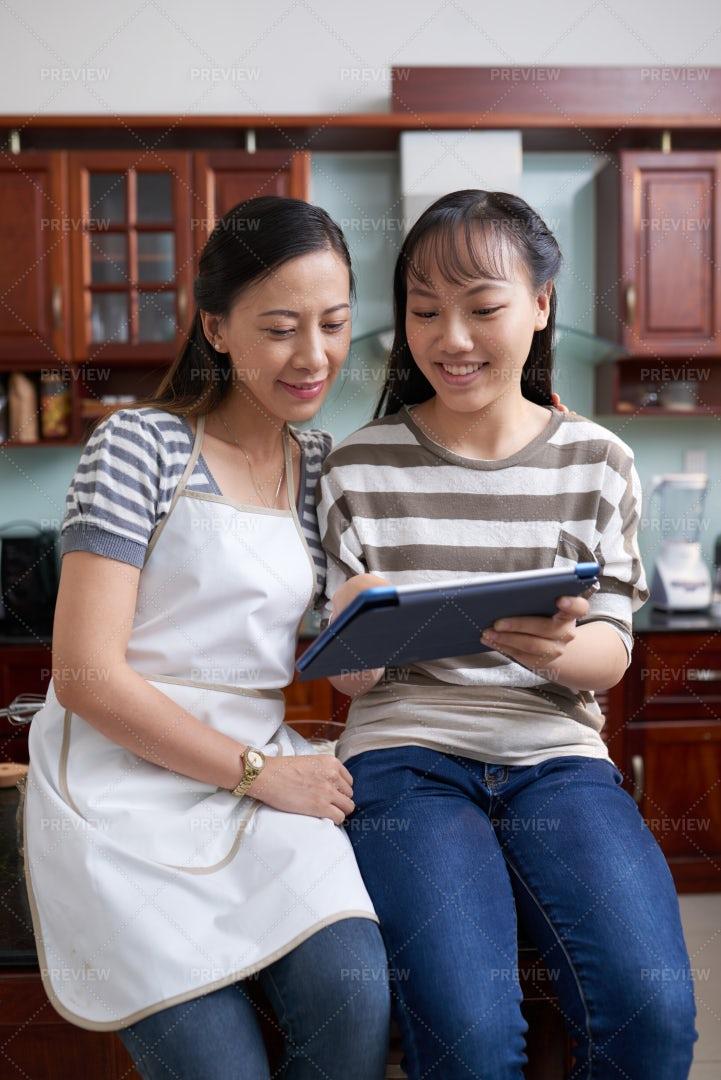 Teenage Girl Showing Mother Recipe: Stock Photos